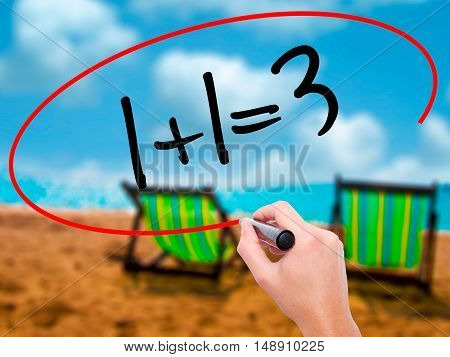 Man Hand Writing 1+1=3 With Black Marker On Visual Screen