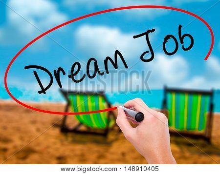 Man Hand Writing Dream Job With Black Marker On Visual Screen