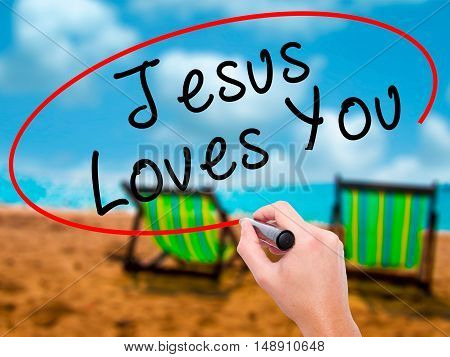 Man Hand Writing Jesus Loves You With Black Marker On Visual Screen
