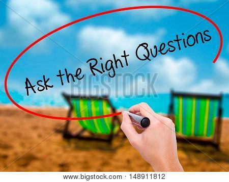 Man Hand Writing Ask The Right Questions With Black Marker On Visual Screen