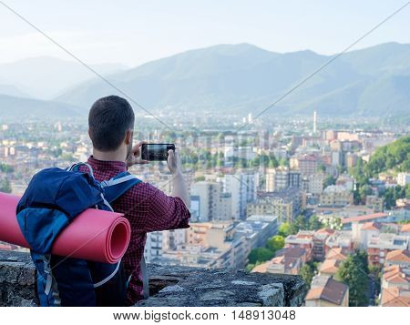 Tourist Taking Picture Of European City
