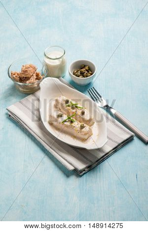 fish fillet with tuna capers and yogurt sauce