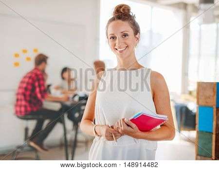 Beautiful Young Woman With Colleagues Meeting In Background