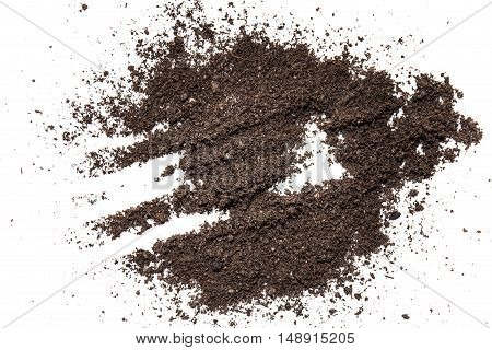 a dirt on a white background in a studio