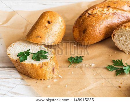 Sliced French Baguette On White Rustic Table