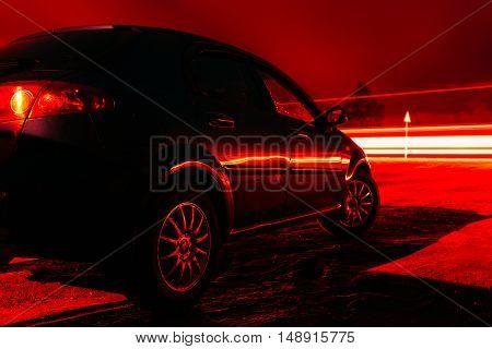 Car parking night long exposure photo. Red Heat version.