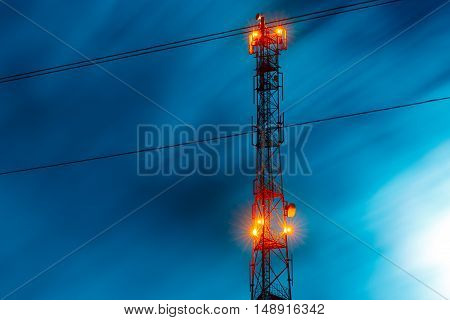 communications tower antenna close-up. blue night sky version