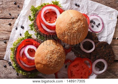 Sandwich With Burgers From Beans And Vegetables Close-up. Horizontal Top View