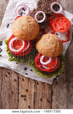Bean Veggie Burgers With Vegetables Close-up. Vertical Top View