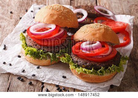 Sandwiches: Black Bean Burgers And Fresh Vegetables Close-up. Horizontal