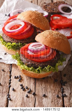 Sandwich With Burgers From Beans And Vegetables Close-up. Vertical