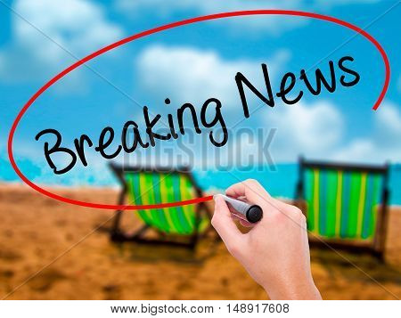 Man Hand Writing Breaking News With Black Marker On Visual Screen