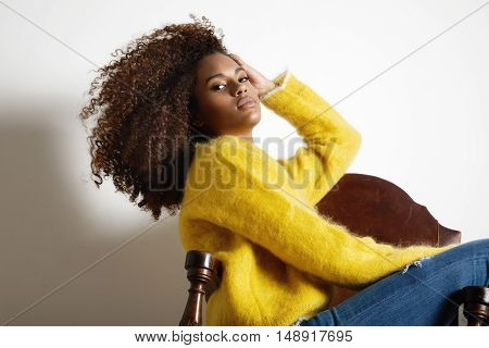 Black Woman Wears Sweater Shows Her Big Afro Hair