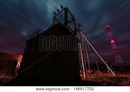 Old electrical transformer station night long exposure photo