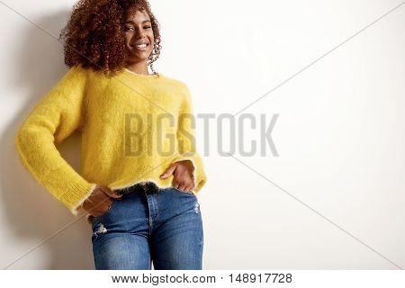 Happy Smiling Black Woman Wears Oversized Yellow Sweater