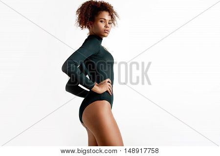 Perfect Shaped Black Woman Wears Green Bodysuit And Watching At Camera