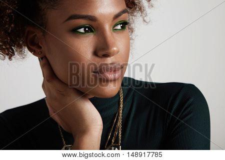 Black Woman With Green Eye Makeup Portrait