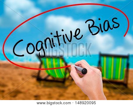 Man Hand Writing Cognitive Bias With Black Marker On Visual Screen
