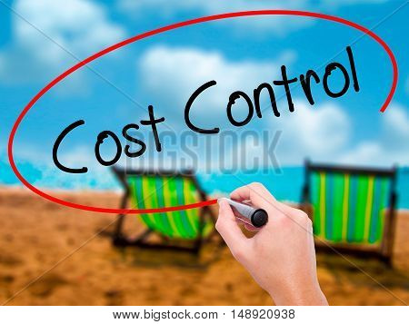 Man Hand Writing Cost Control With Black Marker On Visual Screen