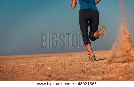 Young woman running in the desert