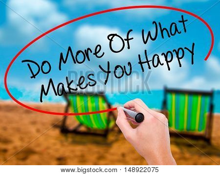 Man Hand Writing Do More Of What Makes You Happy With Black Marker On Visual Screen