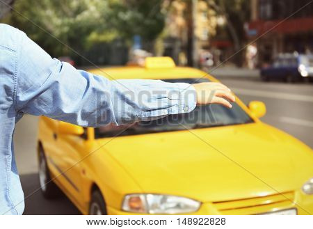 Man stopping taxi, outdoor