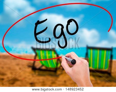 Man Hand Writing Ego With Black Marker On Visual Screen