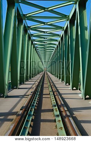 Railway bridge with steel grid structure