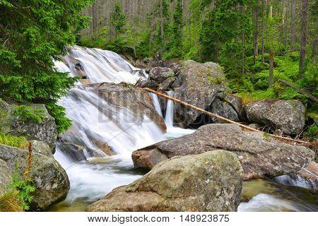 Waterfalls at stream Studeny potok in High Tatras mountains ,Western Carpathians, Slovakia
