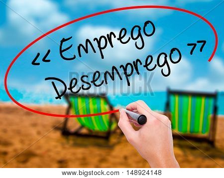 Man Hand Writing Emprego Desemprego (employment - Unemployment In Portuguese)  With Black Marker On