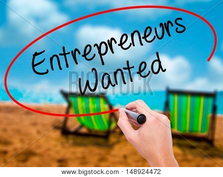 Man Hand Writing Entrepreneurs Wanted With Black Marker On Visual Screen