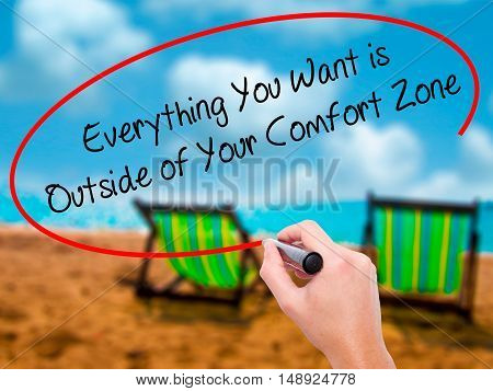 Man Hand Writing Everything You Want Is Outside Of Your Comfort Zone With Black Marker On Visual Scr