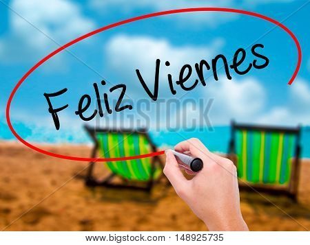 Man Hand Writing Feliz Viernes (happy Friday In Spanish)  With Black Marker On Visual Screen