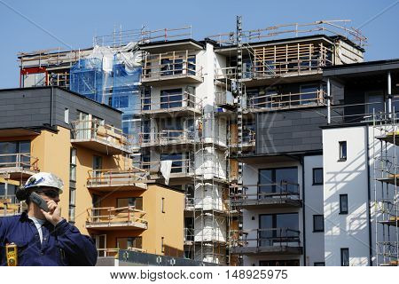 industry worker and construction site, blocks of flats under construction