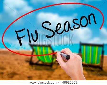 Man Hand Writing  Flu Season With Black Marker On Visual Screen