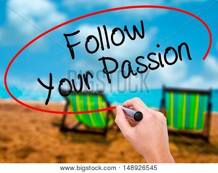 Man Hand Writing  Follow Your Passion With Black Marker On Visual Screen