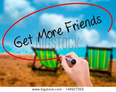 Man Hand Writing Get More Friends With Black Marker On Visual Screen