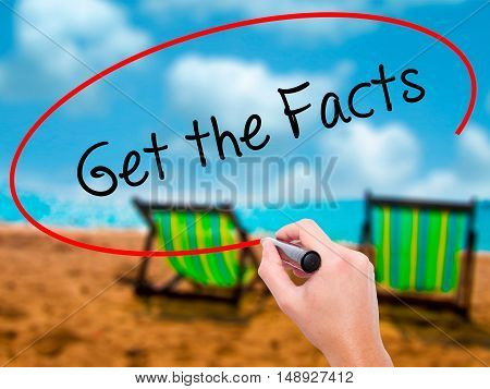 Man Hand Writing Get The Facts  With Black Marker On Visual Screen