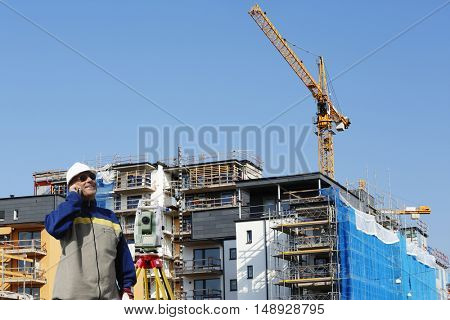 surveying engineer inside construction site, industry