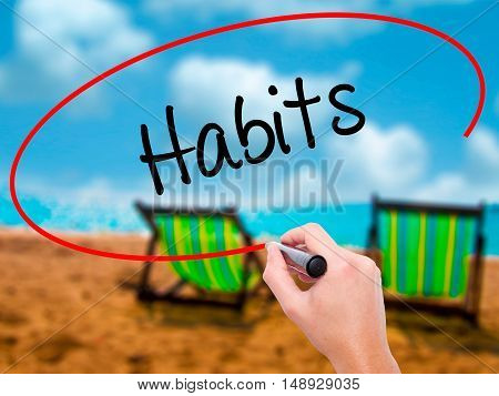 Man Hand Writing Habits  With Black Marker On Visual Screen