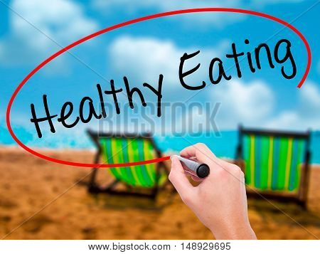 Man Hand Writing Healthy Eating With Black Marker On Visual Screen