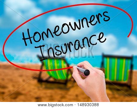 Man Hand Writing Homeowners Insurance With Black Marker On Visual Screen