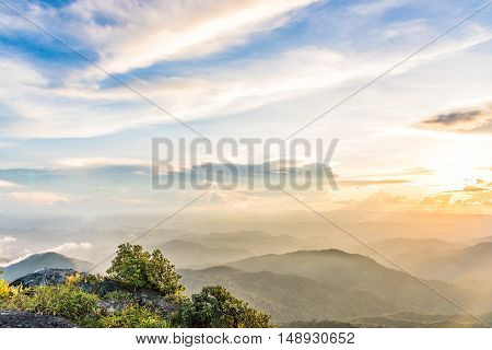 Colorful sky and mountain valley view at sunset.