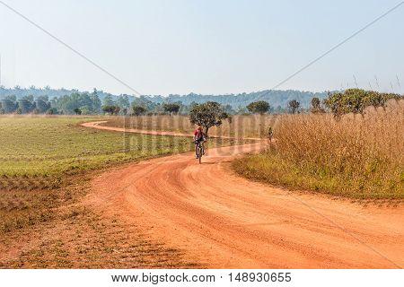 Man riding a mountain bike on a dirt road
