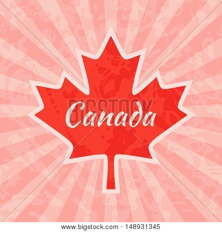 Red maple leaf with text Canada on vintage and retro background.