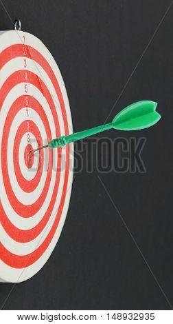 Green dart hits bull's eye