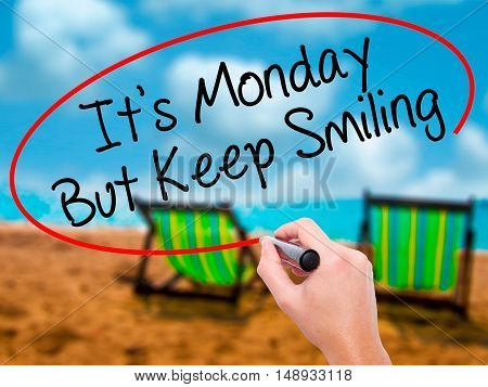 Man Hand Writing It's Monday But Keep Smiling With Black Marker On Visual Screen