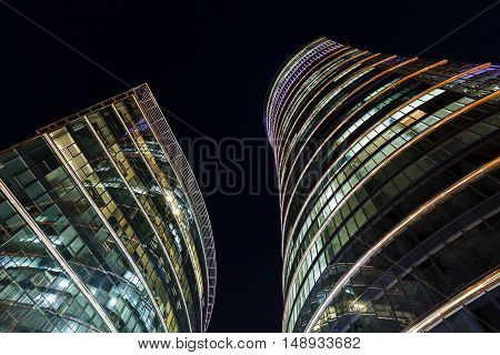 Skyscrapers in the night sky in Warsaw