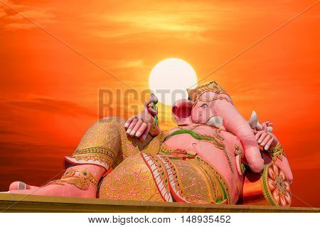 Ganesh statue the largest in the world with the sunset and red sky background.