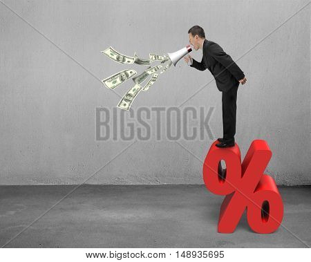 Businessman Hold Megaphone Spraying Out Dollar Bills On Percentage Sign